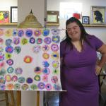 Nicole stands by her cloth art.  Her piece was shown in an art show of her peers at Metzenbaum Opportunity Center.